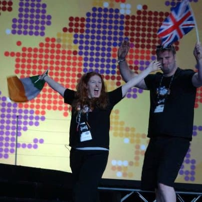 Alexandra and Scott Wickfree walks the scentsy Convention Stage in Las Vegas 2012